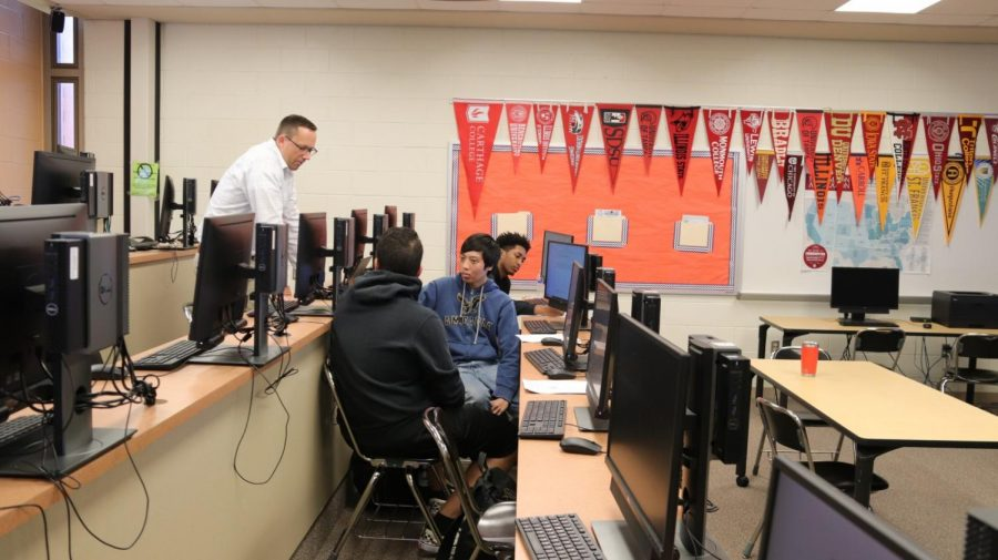 From left to right: counselor Richard Gatz and seniors Ahmad Sandid, Jan Errazo, and Miles Griffin participate in a group guidance session on Sept. 25, learning how to navigate Naviance, an online career and college application aid.
