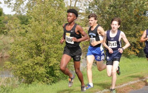 Sophomore Kevin Birge (right) runs in the boys open race at an Oct. 5 meet at Yorkville High School. The team competes on Saturday Oct. 26 for regionals at Hammel Forest Preserve.