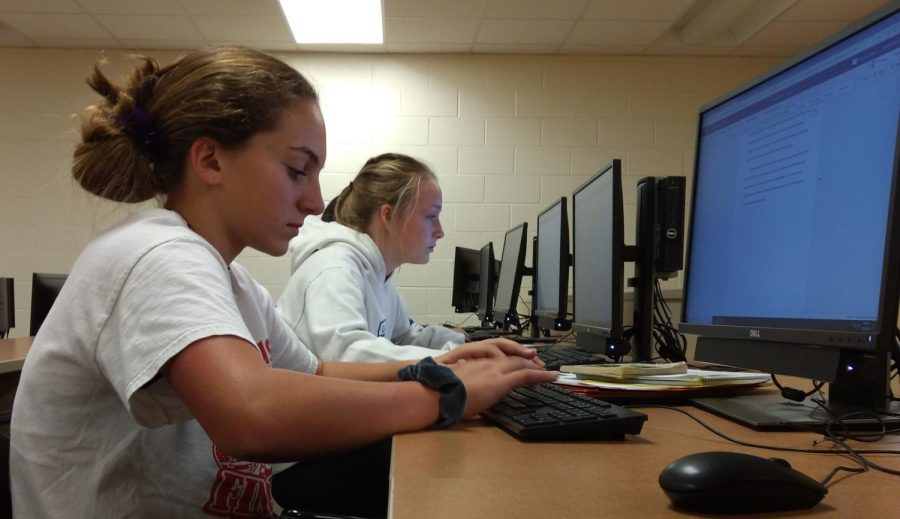 Gianna D'amico (right) and Alyssa Krass (left) work on their Of Mice and Men essays on Oct. 29. The Writing Center is open in room 330 on Mondays, Tuesdays, and Thursdays from 2:20 to 3:30.