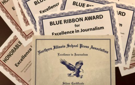 Award certificates pile high for East Side News members