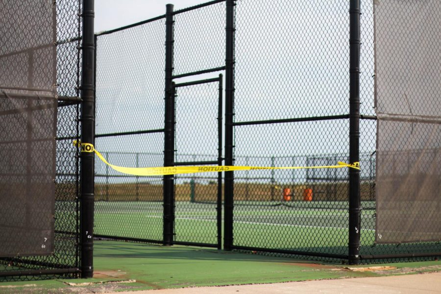 The tennis courts are blocked at East in efforts to keep safe from exposure to COVID-19 earlier in September. The girls tennis team has an upcoming match at West Aurora High School at 4 p.m. Sept. 21. Spectators are limited.  - Adam Jackson