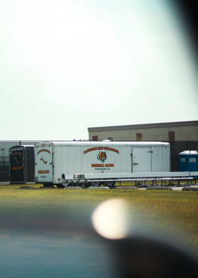 The band trailer sits alone and untouched this year in the parking lot of Plainfield East due to the cancellation of the marching season. However, plans for a virtual performance are in the making. - Mikaela Ramirez