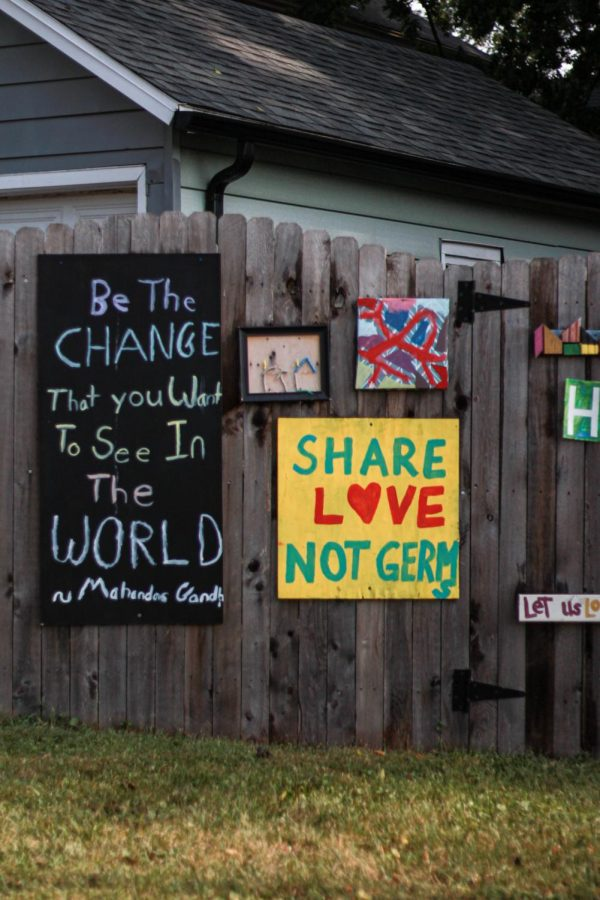 """No matter what unprecedented times are thrown upon the world, art may serve as a constant source of comfort for many. This makeshift art gallery in Plainfield displays words of encouragement such as """"be the change you see in the world"""" and """"share love not germs."""" - Ameera Haque"""